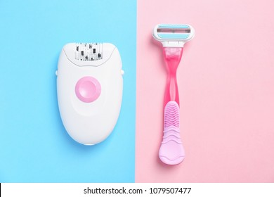 Modern epilator and razor on color background