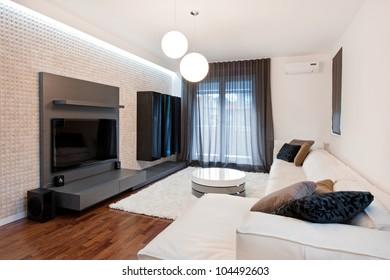 Modern equiped livingroom with big TV screen