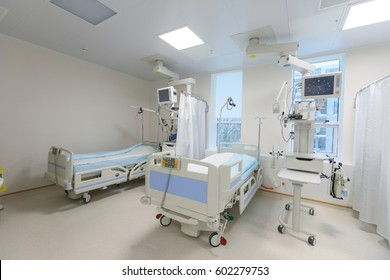 Modern equipped hospital room with two empty beds.