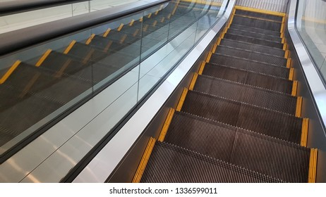 Modern escalator electronic for people up and down in train station.