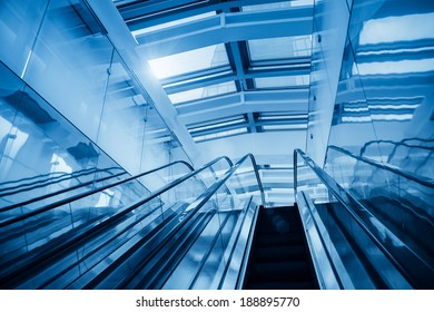 modern escalator in a glass building,abstract space