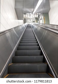 Modern escalator and staircase in subway station
