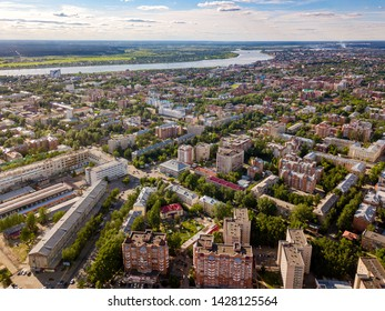 Modern european city view. Ecological green town. Urban and suburbia. Tomsk cityscape and Tom river from aerial view. Siberia, Russia