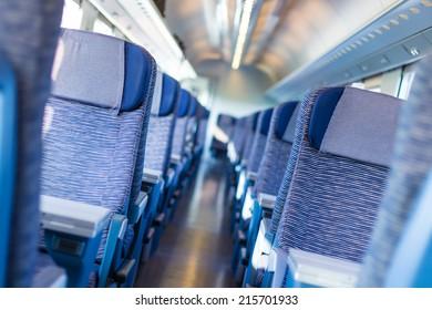 Modern european economy class fast train interior. Inside of high speed train compartment.