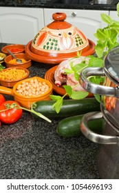 Modern European kitchen with ingredients for a traditional tajine dish as prepared by Moroccan immigrant women during Ramadan nights