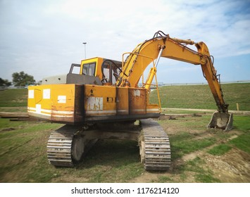 The modern excavator performs excavation work on the construction site.