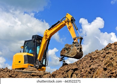 The modern excavator  performs excavation work on the construction site