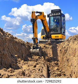 modern excavator performs excavation work on the construction site