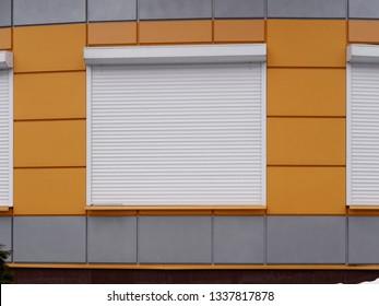 modern exterior design of an office building. roller shut window