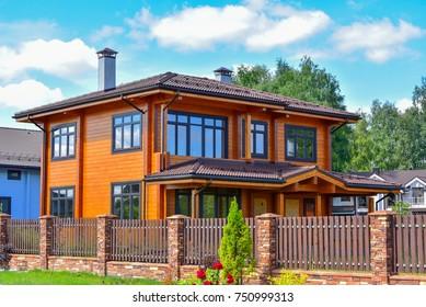 Modern facade of wooden house.