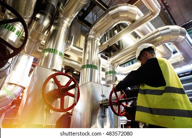 modern factory worker turning valve