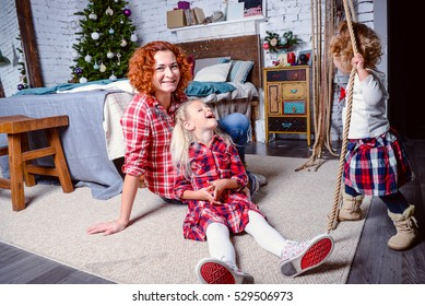 Modern family mother and children daughter christmas portrait. Decorated christmas tree, cozy atmosphere living room. Family Together Christmas Celebration Concept. Merry Christmas and Happy Holidays