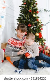 Modern family mother and children son christmas portrait. Decorated christmas tree, cozy atmosphere living room. Family Together Christmas Celebration Concept. Merry Christmas and Happy Holidays