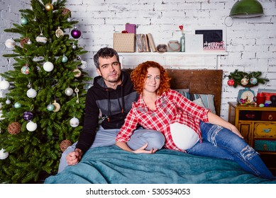 Modern family mother father Christmas portrait. Decorated christmas tree, cozy atmosphere living room. Family Together Christmas Celebration Concept. Merry Christmas and Happy Holidays.