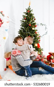 Modern family mother father daughter son christmas portrait. Decorated christmas tree, cozy atmosphere living room. Family Together Christmas Celebration Concept. Merry Christmas and Happy Holidays.
