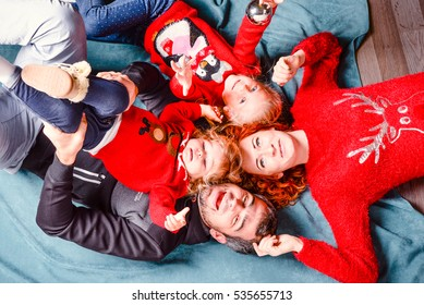Modern family mother father daughter Christmas portrait. Decorated christmas tree, cozy atmosphere living room. Family Together Christmas Celebration Concept. Merry Christmas and Happy Holidays.
