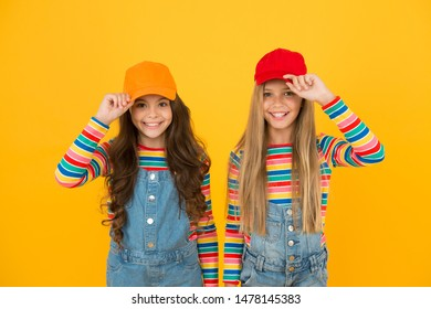 Modern fashion. Kids fashion. Girls long hair wear cap. Cute children wear cap snapback hat. Little girls wearing baseball cap. Matching outfits. Trendy and fancy. Fashion shop. Must have accessory.