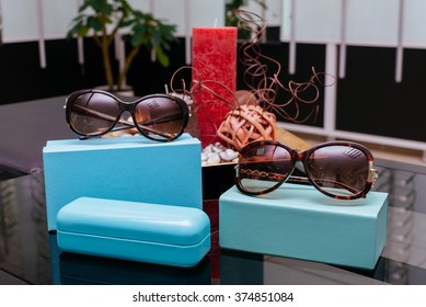 Modern fashion sunglasses with turquoise boxes and spectacle-case
