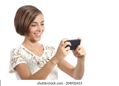 Modern fashion woman watching video in a smart phone isolated on a white background
