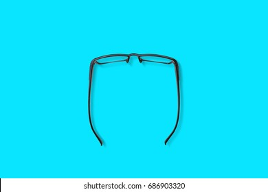 Modern fashionable and office spectacles isolated on blue background, Perfect reflection, eye glasses on table for copy space