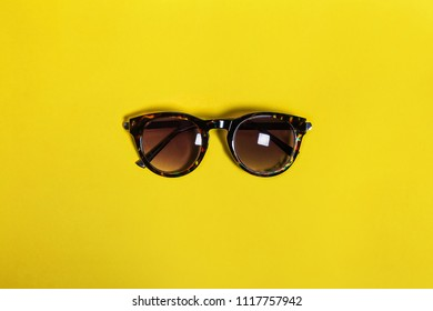 Modern fashionable sunglasses in a black plastic frame lying isolated on white background. concept of summer attributes. free space for text