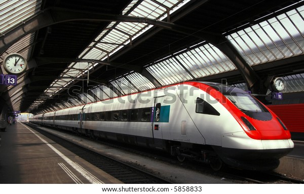 Modern and Fast Commuter Train inside the Depot or Railway Station in Europe.