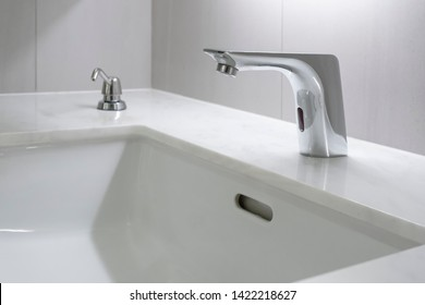 Modern faucet with marble washbasin sink interior contemporary