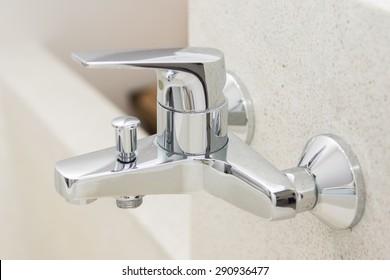 modern faucet on bathtub, bathroom