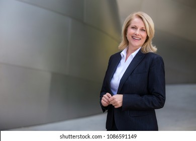 Modern female commercial business woman portrait, dressed with style, wealth, and success