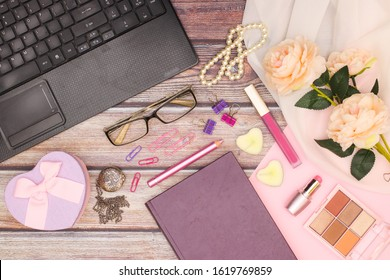 Modern feminine work space and business and finance desk with feminine accessories