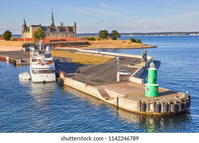 Modern ferry boat at pier, Kronborg castle at backgroung, Danmark, Europe