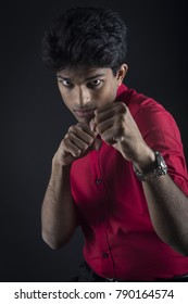 Modern fight club, portrait of a stylish young man in a boxing position