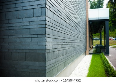 Modern finishing materials in construction. Facing tile on the facade