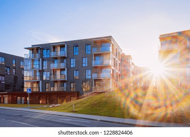Modern flat apartment house and home building real estate concept. Outdoor residential facilities. At sunset