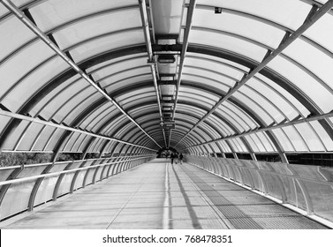 Modern flyover in glass and metal, architecture photography in black and white.