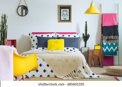 Modern folk bedroom with mix of vivid colors and patterns