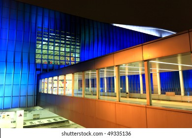 modern footbridge goes into the building
