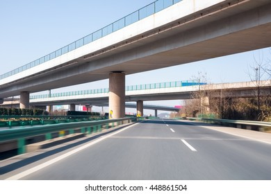 modern freeways and the highway interchange with motion blur