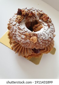 Modern french pastry on old gold plated porcelain