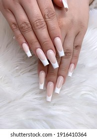 Modern French tip design nails. Pink and white nails. Artificial nail art