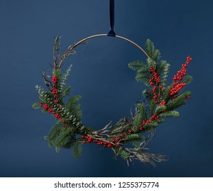 Modern Fresh Greens Christmas Wreath on Blue Background