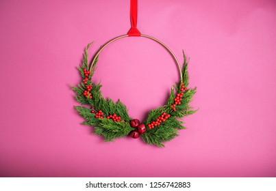 Modern Fresh Greens Christmas Wreath on Pink Background