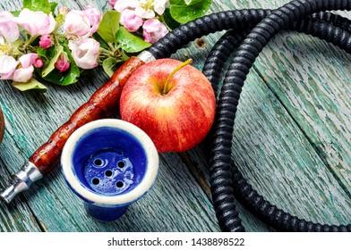 Modern fruit hookah.Eastern shisha with apple.Hookah and apple.