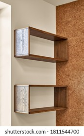 Modern furniture Wall mounted wooden shelves against cork wall background in living room