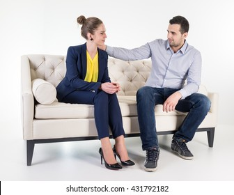 Modern furniture in white room and young couple on