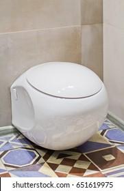 Modern futuristic ceramic toilet in the bathroom