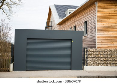 Modern garage door in black / gray