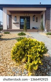 Modern  Garden design. New luxury house exterier. Front door. Thuja.