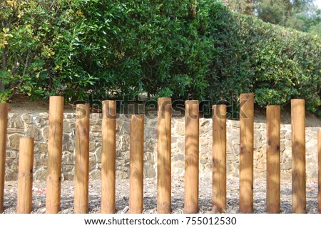 Modern Garden Fencing. New Stake Post, Wooden Fence With Spaces In Between.  Fresh
