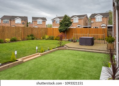 A modern garden with  a new planted lawn decking shrubs  and borders. A good image for Landscape gardiners or designers